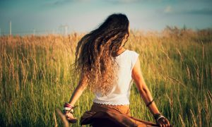 young woman run in summer field of grass retro colors back shot
